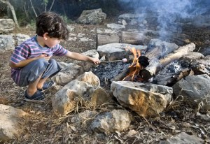 stonebury_learning_marshmallow_boy_campfire