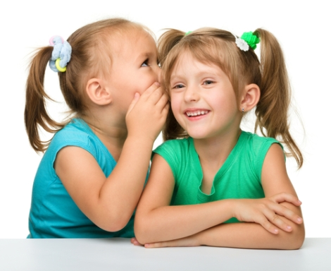 Two girls talking Serhiy Kobyakov Shutterstock
